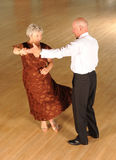 Mature Couple at Formal Dance. Mature couple in formal clothes dancing on a ballroom floor Royalty Free Stock Image