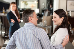 Mature couple in furniture store. Stock Images