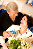 Mature couple with gifts Stock Images