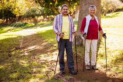 Mature couple going hiking. In a park Royalty Free Stock Images