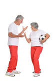 Mature couple are going to play football. Posing on white Stock Photography