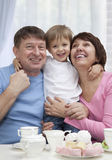 Mature couple with grandchild Stock Photos