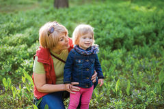 Mature couple with granddaughter. Family concept. Mature couple playing with granddaughter at forest. Family concept Stock Photography