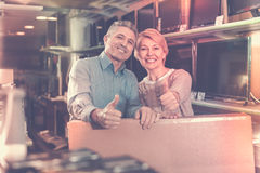 Mature couple are happy with choice and purchased consumer elect Stock Photos