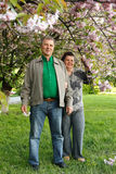 Mature couple happy hug in spring garden Royalty Free Stock Photo