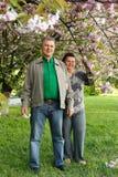 Mature couple happy hug in spring garden. Mature couple cheerful hug in spring garden Royalty Free Stock Photo