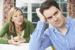 Mature Couple Having Arguement At Home Stock Photography