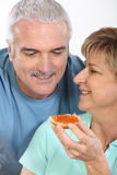 Mature couple having breakfast Royalty Free Stock Image