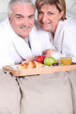 Mature couple having breakfast Stock Photography