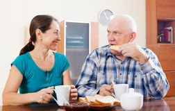 Mature couple having breakfast  in morning Royalty Free Stock Images