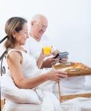 Mature couple having breakfast Stock Photos