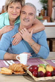 Mature couple having breakfast stock images