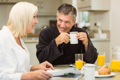 Mature couple having breakfast together Stock Images