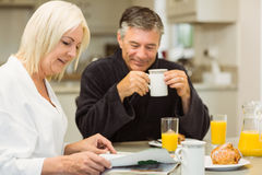 Mature couple having breakfast together Stock Photos