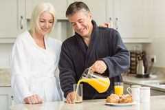 Mature couple having breakfast together Royalty Free Stock Photography