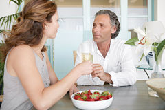 Mature couple having champagne. Stock Photo