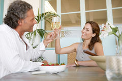 Mature couple having champagne. Royalty Free Stock Photography