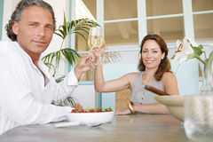 Mature couple having champagne. Stock Images
