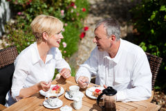 Mature couple having coffee on porch Stock Photos
