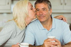 Mature couple having coffee together Royalty Free Stock Images