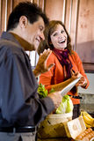 Mature couple having fun cooking in kitchen Royalty Free Stock Photography