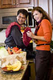 Mature couple having fun cooking in kitchen Stock Photo