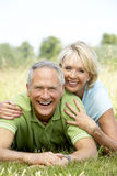 Mature couple having fun in countryside Royalty Free Stock Photos