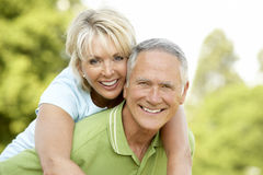 Mature couple having fun in countryside Royalty Free Stock Image