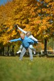 Mature couple having fun in the  park Royalty Free Stock Photos