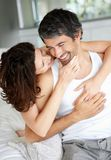 Mature couple having fun together in the bedroom Royalty Free Stock Photo