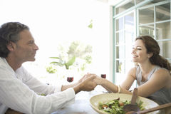 Mature couple having lunch. Stock Images
