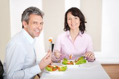 Mature couple having lunch at home Royalty Free Stock Photo