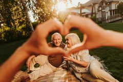Mature couple having picnic outdoors with each other stock photos