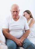Mature couple having quarrel  in   bedroom. Stock Photos