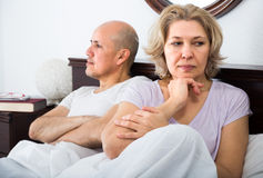 Mature couple having quarrel in bedroom Royalty Free Stock Photos
