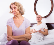 Mature couple having quarrel in bedroom Stock Images