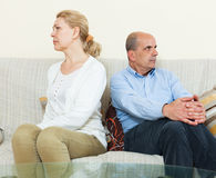 Mature couple having quarrel at home Stock Photos