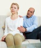 Mature couple having quarrel at home stock photo