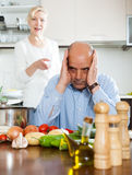 Mature couple having quarrel at kitchen Stock Image