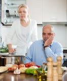 Mature couple having quarrel at kitchen Stock Photos