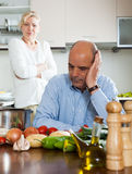 Mature couple having quarrel at kitchen Stock Photo