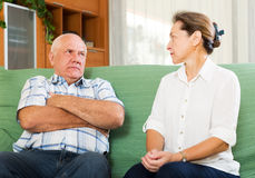 Mature couple having serious talking at home Royalty Free Stock Photography