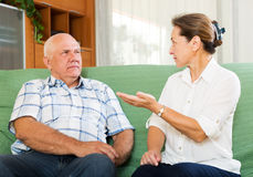 Mature couple having serious talking Royalty Free Stock Photo