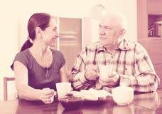 Mature couple having tea with jam Stock Photo
