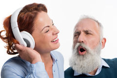 Mature couple with headphones Royalty Free Stock Photo