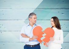 Mature couple holding a broken heart Stock Photography