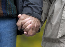 Mature couple holding hands Stock Image