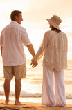 Mature Couple Holding Hands Enjoying at Sunset Stock Images