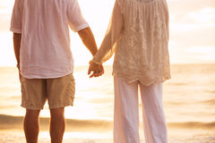 Mature Couple Holding Hands Enjoying at Sunset Royalty Free Stock Photo