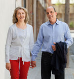 MAture couple holding hands while walking stock image